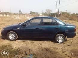 Woman used and neat mazda 323 for sale
