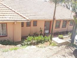 Upper hill 3 bedroom commercial bungalow on a big 1/4acrr