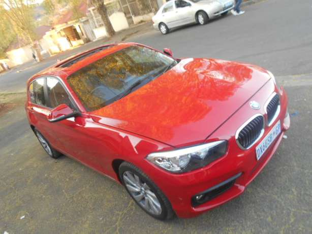 BMW 118i, 2015 model, Red in color, Automatic with a sunroof for sale Johannesburg - image 5