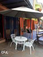 Garden set by 4chairs and table with umbrella