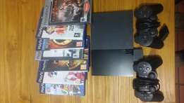 PS2 slim+7 games and 2 remotes