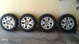 4 Original 15inch BMW Rims and Tyres
