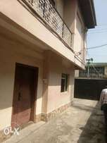 a lovely 2bed at kenel st off bode thomas, surulere. 1mil ,1yr