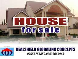 An old bungalow structure on a plot of land for sale