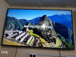 A 65inches UHD Samsung smart TV, model number is UE65JU6800