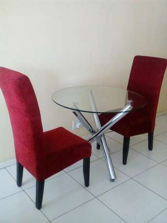 Two chairs with glass table for 2200 all of them Or Tambo Int Airport - image 2