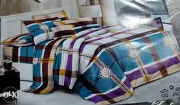 Duvets with a pair of pillow cases and a bed sheets at120k