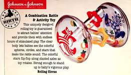 A combination Rattle & Activity Toys by Johnson & Johnson / USA Toys