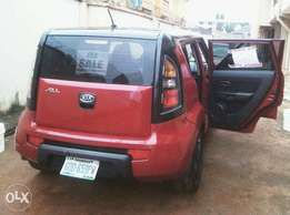 A clean Red sweet and comfortable Kia for sale. The price is negotiabl