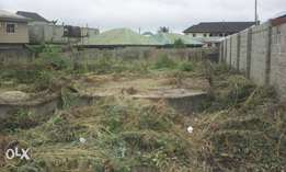 One and a quater plot of land with foundation on it at Era,Ijanikin.