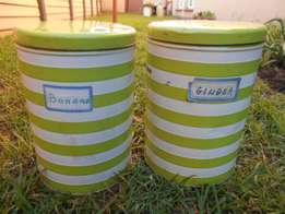 2 green and white striped tins