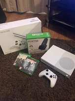 In boxed new xbox one S 500GB plus 2 games come with warranty