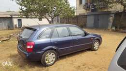 Super clean toks 2001 model Mazda 323f for sale