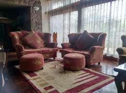 4 seater couch/sofa with poof and cushion
