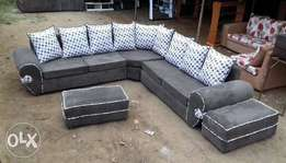 7 seater Lshaped seat plus 2 ottomans