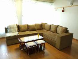 New 7 seater L -shaped sofa, free delivery within Nakuru.