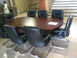 Boardroom table with 8 leather chairs. In good condition.