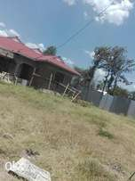 Land with three bedroom bungalow unfinished(not painted)