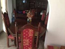 Neatly used dining table with 6 chairs.