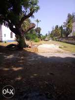 2 acre plot with a house in it going direct up to the Beach .