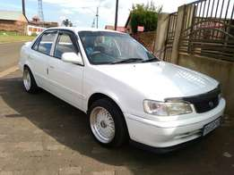 Call Haroon on 2000 Toyota Corolla 160i GLE with Mags sound