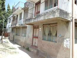 Building with title in Bamburi at special reduced price.