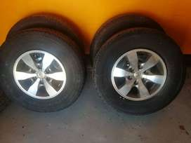 Toyota Hilux 16'' mags and new tyres.
