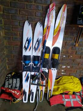 Skis, life jackets and ski rope for sale.