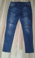 spodnie jeansowe z przetarciami roz. 42