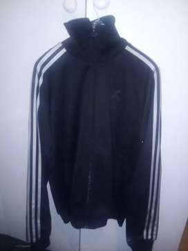 Black and silver Adidas track top