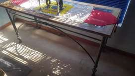 Cast iron table with wooden and glass top