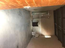 Garadge Sized Room with inside shower basin and toilet.