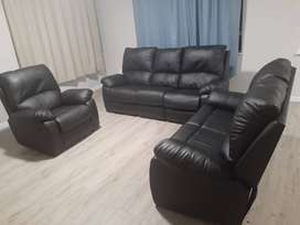 Fridge, couch, coffee table, tv stand and 2 beds