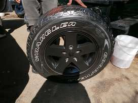 5 jeep wrangler rims and tyres.