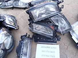 Mazda 323 left and right head lamp