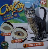 Туалет для кошки - средство для похода на унитаз