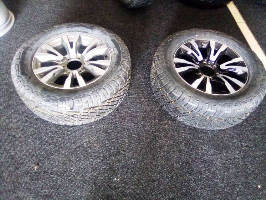 """18"""" Isuzu mag rims with brand new General grabbers to use for spare"""