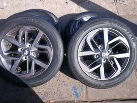 A set of Center rims and tyres 14inche for sale it's available now