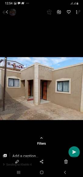 2 bedroom house with 7flats for sale by owner