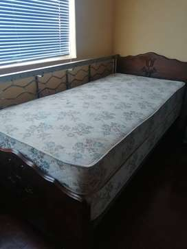 Two single imbuia wood beds for sale