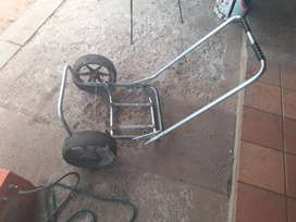 Welder and battery charger and trolley.