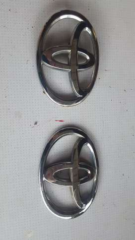 Two toyota badges