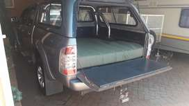 High density bakkie mattress with canvas cover.