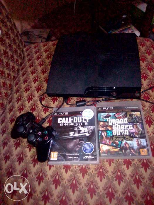 PS3 console with games and controller. 0