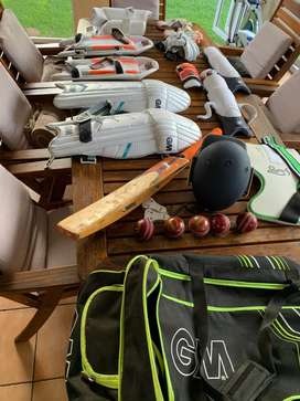 Cricket kit complete with bat, new balls, wicket keeper gear.