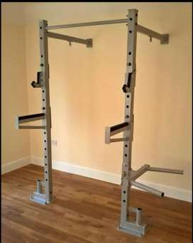 Wall mounted squat rack and pull up bar. Includes dipping  and spotter
