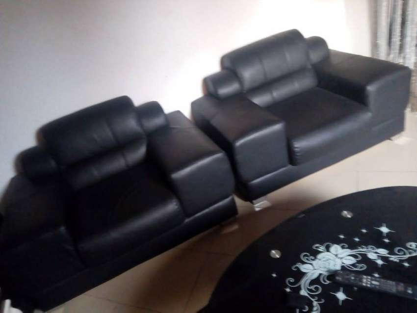 Two single one double, black leather chairs 0