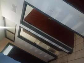 A big bedroom with fitted wardrobes R2500.