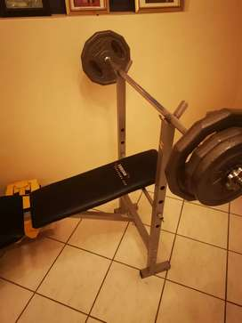 Bench with barbell and weights
