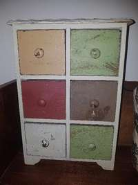 Image of Small wooden cabinet with drawers